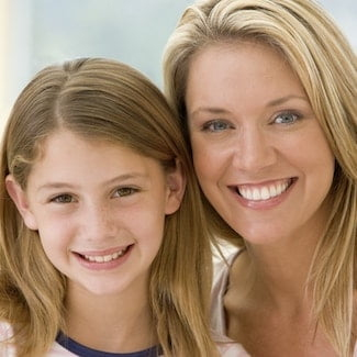 Mother and daughter who have had a fluoride treatment as part of Dentistry in Seattle