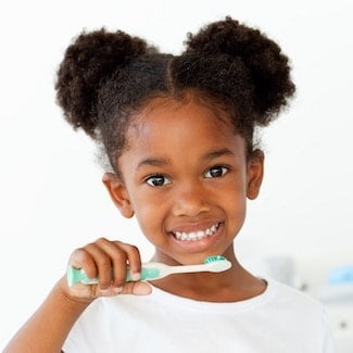 Little girl who has just had sealants and loves dentistry in Seattle