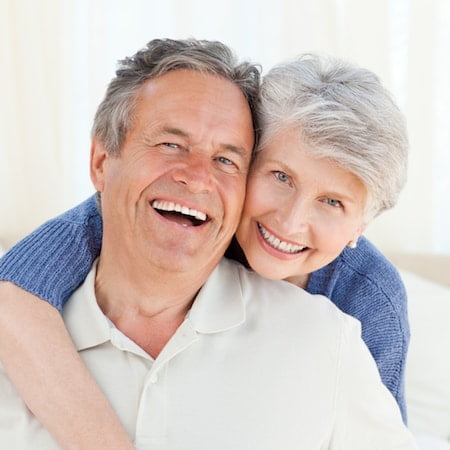 Happy couple who have natural-looking dentures due to Seattle Cosmetic Dentistry
