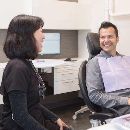 Dr. Fu with a patient in our wonderful Seattle Dentist Office.